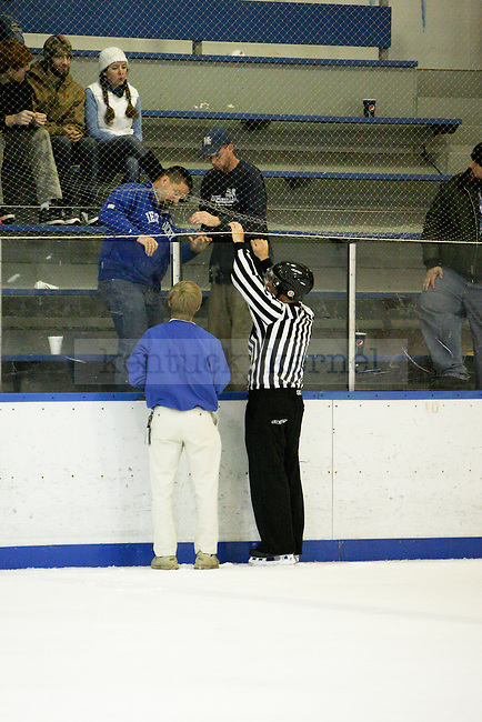 Lexington Ice Center staff work with the referee to fix the boards during the UK men's hockey game versus Missouri at Lexington Ice Center in Lexington, Ky., on Saturday, November, 9, 2013. Photo by Jonathan Krueger | Staff