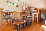 A reading nook surrounded by floor-to-ceiling bookshelves offers a quiet space in this open contemporary cottage. This image is available through an alternate architectural stock image agency, Collinstock located here: http://www.collinstock.com