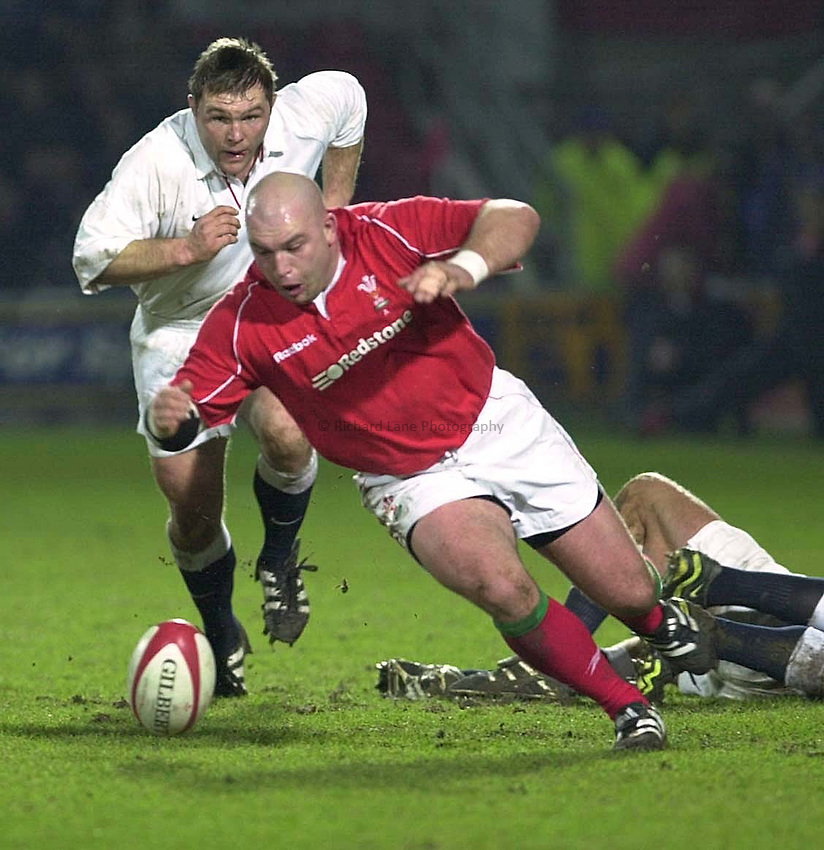 Photo Mike Brett 2201 Wales A v England A.Wales R.U. prop Ben Evans drops down in front of John Mallett