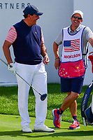 Phil Mickelson (USA) shares a laugh with this brother and caddie, Tim on the first tee during round 2 Four-Ball of the 2017 President's Cup, Liberty National Golf Club, Jersey City, New Jersey, USA. 9/29/2017.<br /> Picture: Golffile | Ken Murray<br /> <br /> All photo usage must carry mandatory copyright credit (&copy; Golffile | Ken Murray)