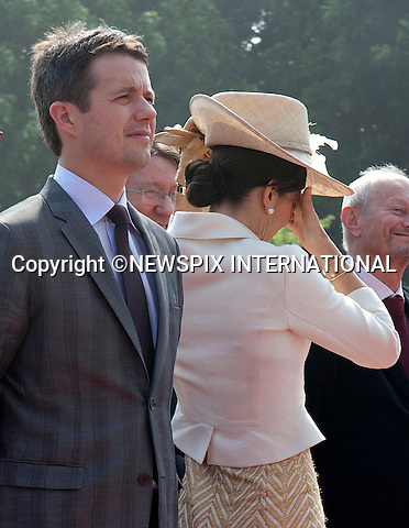 "EMBARRASING MOMENT FOR CROWN PRINCESS MARY.Having to stand to atention as the National Anthem was played, left the Princess open to the elements..A sudden gust of wind lifted the Princess hat clean-off her head, but fortunately it did not go to far and was rescued. The Crown Princess looked red-faced and terribly embarrased and it was minutes before she regained her composure..Queen Margrethe, The Prince Consort Henrik, Crown Prince Fredrik and Crown Princess Mary on Day 1 f their 5-day state visit Vietnam. .Vietnam is the first Royal visit the Danish Royal Family has taken together. The Danish Royals attendded a Welcome Ceremony at the Presidential Palace hosted by President Nguyen Minh TRIET and First Lady Tran Thi Kim Chi, after which they laid wreaths at the National Heroes and Martyrs Monument as well as the Ho Chi Minh Mausoleum, Hanoi, Vietnam_02/11/2009..Mandatory Photo Credit: ©Dias/Newspix International..**ALL FEES PAYABLE TO: ""NEWSPIX INTERNATIONAL""**..PHOTO CREDIT MANDATORY!!: NEWSPIX INTERNATIONAL(Failure to credit will incur a surcharge of 100% of reproduction fees)..IMMEDIATE CONFIRMATION OF USAGE REQUIRED:.Newspix International, 31 Chinnery Hill, Bishop's Stortford, ENGLAND CM23 3PS.Tel:+441279 324672  ; Fax: +441279656877.Mobile:  0777568 1153.e-mail: info@newspixinternational.co.uk"