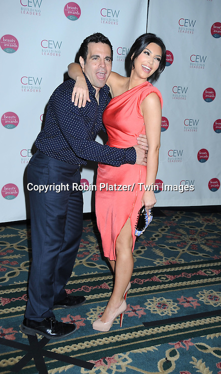 Mario Cantone and Kim Kardashian in Rachel Roy coral dress posing for photographers at The 2010 Cosmetic Executive Women Beauty Awards on May 21, 2010 at The Waldorf Astoria Hotel in New York City.