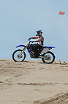 Dirt Bike on Oregon dune horizon