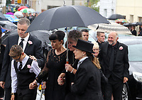 COPY BY TOM BEDFORD<br /> Pictured: Gemma Black, Pearl's mum (C) joined by family and friends arrives at the Jerusalem Baptist Chapel in Merthyr Tydfil, Wales, UK. Friday 18 August 2017<br /> Re: The funeral of a toddler who died after a parked Range Rover's brakes failed and it hit a garden wall which fell on top of her will be held today at Jerusalem Baptist Chapel in Merthyr Tydfil.<br /> One year old Pearl Melody Black and her eight-month-old brother were taken to hospital after the incident in south Wales.<br /> Pearl's family, father Paul who is The Voice contestant and mum Gemma have said she was &quot;as bright as the stars&quot;.