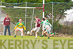 Davon O'Flaherty Cromane shoots under pressure from Jim Cremin Ballydonohue as keeper Sean Thornton watches during their league game in Cromane on Sunday