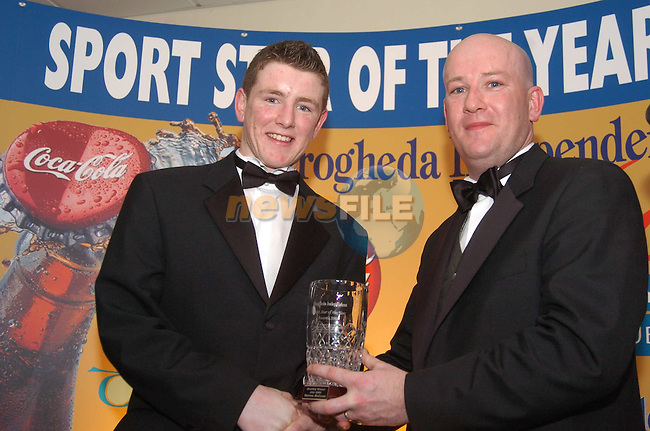 Sport Star of the Year 2003 Sponsored by Drogheda Concentrates in Association with the Boyne Valley Country Club..Gary McCann Drogheda Concentrates presents July winner Darren McCann with his award.Photo Fran Caffrey/Newsfile.ie...This Picture has been sent to you by Newsfile Ltd..The Studio,.Millmount Abbey,.Drogheda,.Co. Meath,.Ireland..Tel: +353(0)41-9871240.Fax: +353(0)41-9871260.ISDN: +353(0)41-9871010.www.newsfile.ie..general email: pictures@newsfile.ie