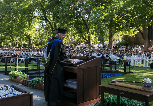 President Marc Johnson addresses the audience during the University of Nevada College of Agriculture, Biotechnology & Natural Resources and College of Education graduation ceremony on Friday evening, May 19, 2017.