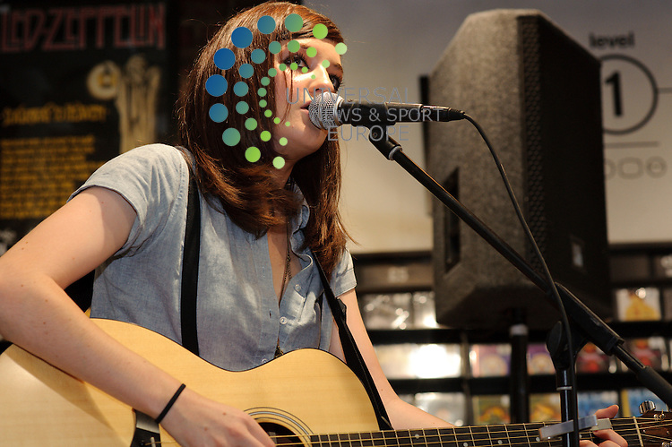 Katie Sutherland aka Pearl of Pearl and the Puppets perform at Glasgow's Fopp music store. The band played to a small crowd to celebrate the launch of their new ep 'Make Me Smile' before signing merchandise for fans..Fopp, Union Street, Glasgow , Scotland .  Picture: Euan Anderson/Universal News And Sport (Scotland) 16th August 2010.