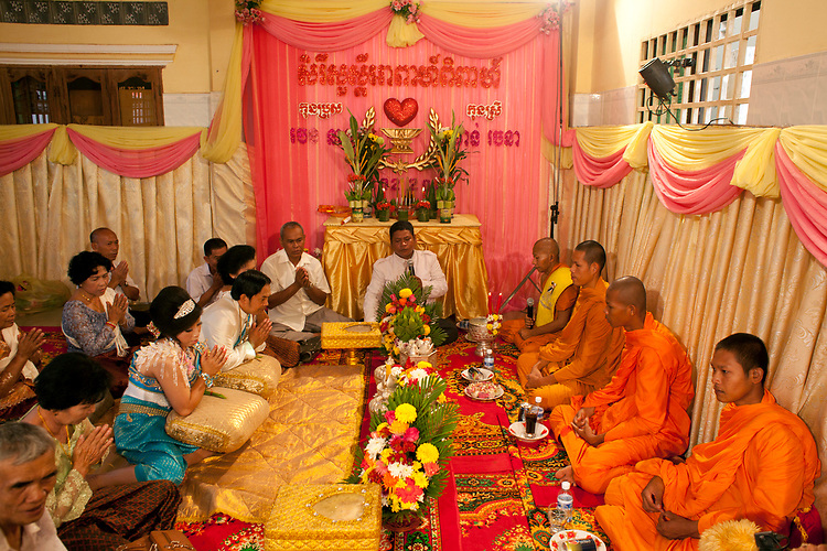 A buddhist wedding in a small village outside of Phnom Penh, Cambodia. <br /> <br /> Photos &copy; Dennis Drenner 2013.