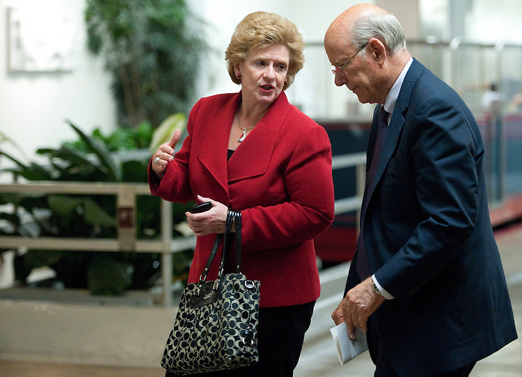 UNITED STATES - JUNE 21: Sen. Debbie Stabenow, D-Mich., talks with Sen. Pat Roberts, R-Kan., as they arrive in the Capitol for a vote via the Senate subway on Tuesday, June 21, 2011. (Photo By Bill Clark/Roll Call)
