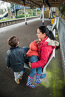A mother breastfeeding her three and a half year old boy at a train station.<br /> <br /> Surrey, England, UK<br /> 03/01/2015<br /> <br /> &copy; Paul Carter / wdiip.co.uk