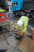 A London Highways Alliance pavement repair team at work on a Clean Up Day organised by Edgware Road  Partnership.