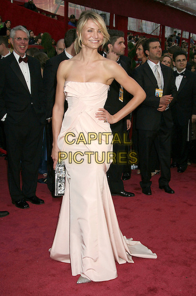 CAMERON DIAZ.The 80th Annual Academy Awards Arrivals held at the Kodak Theatre, Hollywood, California, USA..February 24th, 2008.full length strapless dress white cream gathered hand on hip silver clutch bag purse pink oscars.CAP/ADM/RE.©Russ Elliot/AdMedia/Capital Pictures.