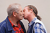 Portrait of gay couple kissing,