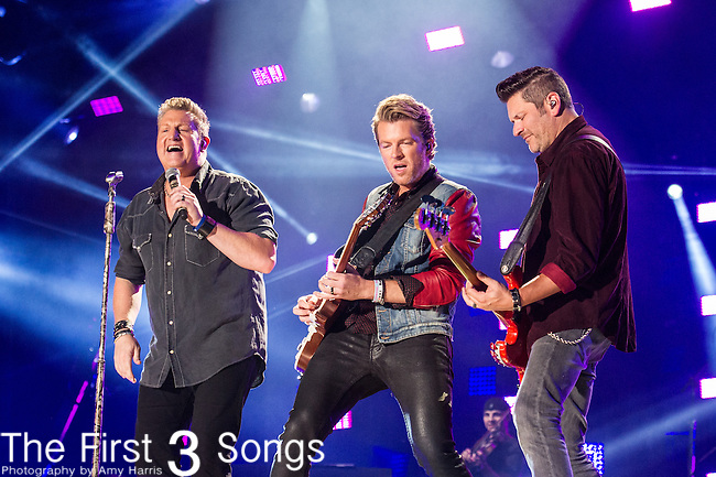 Jay DeMarcus, Joe Don Rooney, and Gary LeVox of Rascal Flatts performs at LP Field during Day One of the 2014 CMA Music Festival in Nashville, Tennessee.