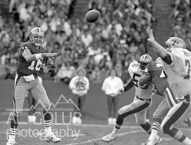San Francisco 49ers vs New Orleans Saints  at Candlestick Park Sunday, November 15, 1987.. Saints beat 49ers 26-24.San Francisco 49ers Quarterback Joe Montana (16).