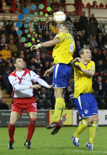 Morton's Erik Paartalu outjumps team mate peter Weatherson and Airdrie's Richard Waddell during the Irn-Bru Scottish First Division match between Airdrie United and Morton at Excelsior Stadium 21/11/09..Picture by Ricky Rae/universal News & Sport (Scotland).