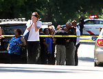 Woodbridge police on scene along Devon Road in the Colonia section of Woodbridge on Wednesday July 22,2015.<br /> Here a woman reacts as she elves the crime scene area that is behind her along Devon Rd.
