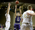 SIOUX FALLS, SD: Tom Aase #14 from the University of Sioux Falls shoots over Taylor Schafer #20 from Southwest Minnesota State in the first half of their NSIC Tournament game Sunday at the Sanford Pentagon (Photo by Dave Eggen/Inertia)