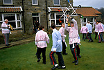 """BRITISH COUNTRY CUSTOMS, """"GOATHLAND PLOUGH STOTS"""" YORKSHIRE. TEENAGE BOYS IN COSTUMES DANCING WITH SWORDS- FORMED STAR IN GARDEN."""
