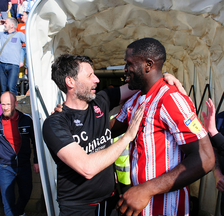 Lincoln City manager Danny Cowley, left, celebrates securing the League 2 Title with John Akinde<br /> <br /> Photographer Andrew Vaughan/CameraSport<br /> <br /> The EFL Sky Bet League Two - Lincoln City v Tranmere Rovers - Monday 22nd April 2019 - Sincil Bank - Lincoln<br /> <br /> World Copyright © 2019 CameraSport. All rights reserved. 43 Linden Ave. Countesthorpe. Leicester. England. LE8 5PG - Tel: +44 (0) 116 277 4147 - admin@camerasport.com - www.camerasport.com