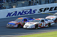 Nationwide: Teammates Kyle Busch (#18) and Joey Logano (#20) race for the win.