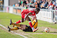 Danny Holmes of Newport County gets to grips with new loan signing Tariqe Fosu of Accrington Stanley during the Sky Bet League 2 match between Newport County and Accrington Stanley at Rodney Parade, Newport, Wales on 28 March 2016. Photo by Mark  Hawkins.