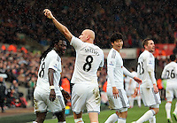 SWANSEA, WALES - FEBRUARY 21: Jonjo Shelvey (R) of Swansea celebrates his goal with team mate Bafetimbi Gomis, making the score 2-1 to his team during the Barclays Premier League match between Swansea City and Manchester United at Liberty Stadium on February 21, 2015 in Swansea, Wales.