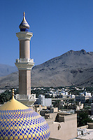 Nizwa, Oman, Arabian Peninsula, Middle East - Mosque dome and minaret.