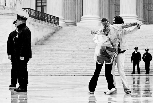 Makenzi Smith, of Norman, Okla., and Mallee McGee, of Midwest City, Okla., dance on the plaza of the Supreme Court in the rain on April 29, 2009, to music courtesy of a nearby NAACP rally. The two girls were part of a school group from the Christian Heritage Academy waiting in line to get into the Supreme Court, which was hearing a case on the Voting Rights Act.