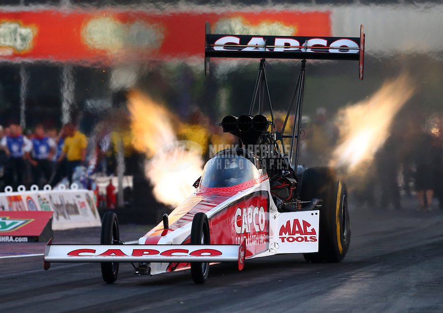 Apr 25, 2014; Baytown, TX, USA; NHRA top fuel dragster driver Steve Torrence during qualifying for the Spring Nationals at Royal Purple Raceway. Mandatory Credit: Mark J. Rebilas-USA TODAY Sports