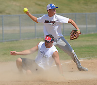 NWA Democrat-Gazette/ANDY SHUPE<br /> Avery Logan (top), third baseman for the Adda-Boyz softball team, throws across the diamond Saturday, Aug. 15, 2015, as Bobby Skelton of the Quick and Dead team slides in safely at the bag during the 33rd annual Tyson Foods Corporate Softball Tournament at the Randal Tyson Sports Complex in Springdale.
