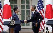 Japan's Prime Minister Shinzo Abe and US President Barack Obama shake hands after holding a joint press conference at The White House in Washington DC for a State Visit, April 28, 2015. Credit: Chris Kleponis / CNP