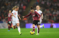 9th November 2019; Wembley Stadium, London, England; International Womens Football Friendly, England women versus Germany women; Lina Magull of Germany plays the ball through under pressure from Jordan Nobbs of England - Editorial Use