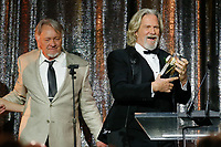ASC Board of Governors Award honoree Jeff Bridges, right accepts his award from his stand in and stunt double Loyd Catlett, left, at the 33rd annual ASC Awards and The American Society of Cinematographers 100th Anniversary Celebration at the Ray Dolby Ballroom at Hollywood &amp; Highland, Saturday, February 9, 2019 in Hollywood, California.  <br /> CAP/MPI/IS<br /> &copy;IS/MPI/Capital Pictures