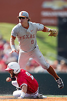 Texas Longhorns second baseman Brooks Marlow (8) jumps over Houston Cougars base runner Michael Pyeatt (2) at second base during the NCAA baseball game on June 6, 2014 at UFCU Disch–Falk Field in Austin, Texas. The Longhorns defeated the Cougars 4-2 in Game 1 of the NCAA Super Regional. (Andrew Woolley/Four Seam Images)