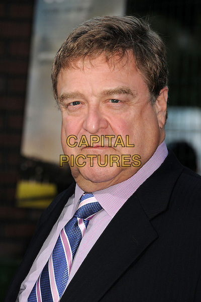 "John Goodman.""Trouble With The Curve"" Los Angeles Premiere held at the Regency Village Theatre, Westwood, California, USA..September 19th, 2012.headshot portrait suit black blue tie pink shirt  .CAP/ADM/BP.©Byron Purvis/AdMedia/Capital Pictures."