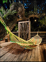 BNPS.co.uk (01202 558833)<br /> Pic: Mallinson/BNPS<br /> <br /> Outdoor  hammock...<br /> <br /> Release your inner Tarzan...in Britain's poshest treehouse.<br /> <br /> A luxury glamping site in deepest Dorset has created a luxurious treehouse that comes with its own sauna, hot tub, rotating fireplace and pizza oven.<br /> <br /> The Woodsman's Treehouse is perched 30ft from the ground on long stilts and has two floors. <br /> <br /> It has a spiral staircase and a stainless steel slide for quick access to the ground and can be rented out from &pound;390 a night. <br /> <br /> It is located at the Crafty Camping glamping site at Holditch in west Dorset.