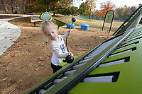 NWA Democrat-Gazette/J.T. WAMPLER Millie Goldberg, 3, of Fayetteville plays on the xylophone Monday Nov. 13, 2017 at the David Lyle Bayyari Music Playground at Wilson Park in Fayetteville. The playground features several musical instruments and in a recent addition to the park.