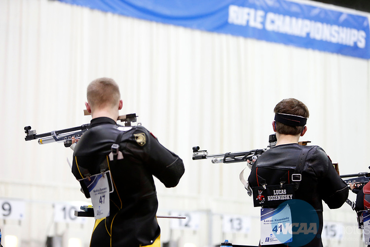 COLUMBUS, OH - MARCH 11:  Nathan Brewer, left, of the U.S. Military Academy, and Lucas Kozeniesky, of North Carolina State University, compete during the Division I Rifle Championships held at The French Field House on the Ohio State University campus on March 11, 2017 in Columbus, Ohio. (Photo by Jay LaPrete/NCAA Photos via Getty Images)