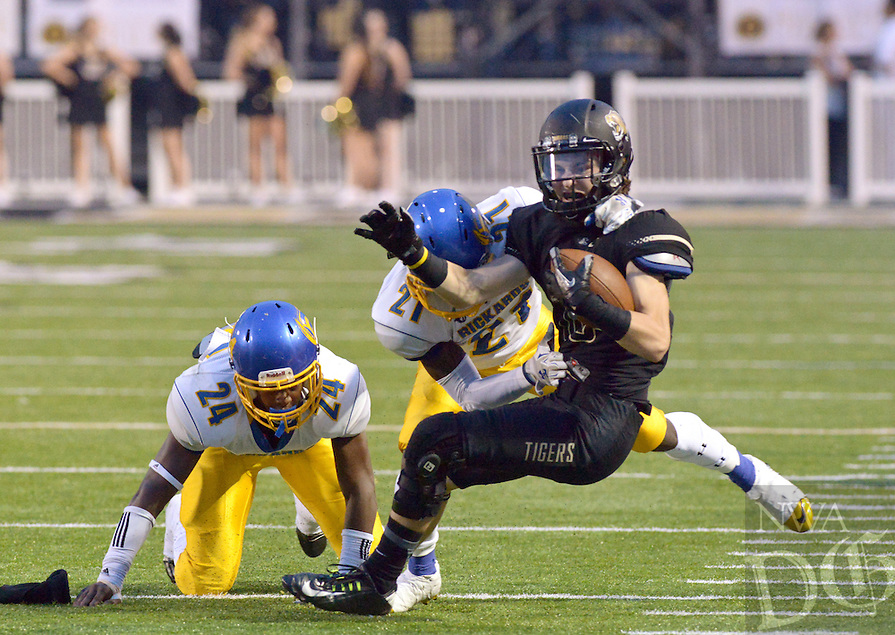 NWA Democrat-Gazette/BEN GOFF @NWABENGOFF<br /> Laron Fryson, Tallahassee (Fla.) Rickards defensive back, tackles Hadley Gregg, Bentonville wide receiver, on Friday Sept. 18, 2015 during the first quarter of the game in Bentonville's Tiger Stadium.