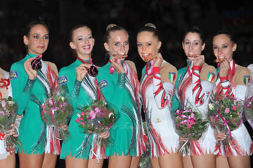 September 24, 2011; Montpellier, France;  (L-R) ELISA SANTONI,  ANZHELIKA SAVRAYUK, MARTA PAGNINI, ANDREEA STEFANESCU, ELISA BIANCHI, ROMINA LAURITO of Italian group celebrate winning gold in the groups all around final at 2011 World Championships.