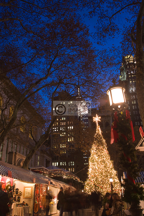 CHRISTMAS TREE LIGHTS BRYANT PARK CHRISTMAS MARKET MANHATTAN NEW YORK CITY USA