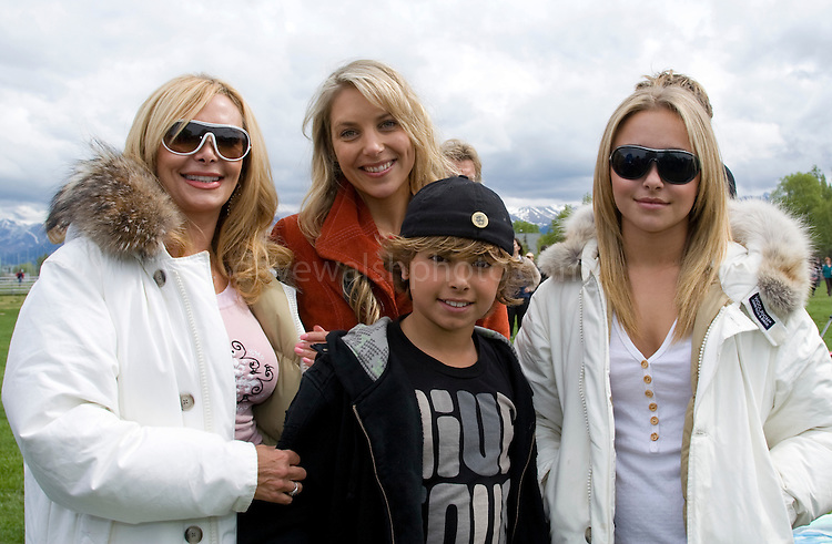 """L-R front: Leslie Vogel her son Jansen Panettiere and daughter Hayden Panettiere of Save the Whales Again from United States of America....L-R  Back: Hanna Fraser, Howie Cook and Dave Rastovich of sufers against cetaceans from Australia....Hollywood star of """"Heroes"""" Hayden Panettiere, of Save the Whales Again Campaign, joins a Greenpeace parade in Anchorage Alaska, as part of a global day of activities with thousands of people, across twenty countries and more than fifty cities to send a message to delegates of the International Whaling Commission, meeting this week in Alaska to decide the future of the great whales. ..Hundreds of thousands of whales die every year because of human impacts such as pollution, ships strikes, climate change and being caught in nets, yet the Commission will focus discussion on where, when and how to hunt them. ..copyright: Walsh/Greenpeace"""