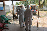 Health care workers make their rounds as they care for patients, including two new patients, in the ELWA II ETU (Ebola treatment unit), Monrovia, Liberia on Monday, March 9, 2015.  <br /> Occidental College professor Mary Beth Heffernan's PPE Portrait Project involves creating wearable portraits of the health care workers who must wear PPE (personal protective equipment) when working with patients.<br /> (Photo by Marc Campos, Occidental College Photographer), 2015. <br /> Occidental College professor Mary Beth Heffernan's PPE Portrait Project involves creating wearable portraits of the health care workers who must wear PPE (personal protective equipment) when working with patients.<br /> (Photo by Marc Campos, Occidental College Photographer) Mary Beth Heffernan, professor of art and art history at Occidental College, works in Monrovia the capital of Liberia, Africa in 2015. Professor Heffernan was there to work on her PPE (personal protective equipment) Portrait Project, which helps health care workers and patients fighting the Ebola virus disease in West Africa.<br />
