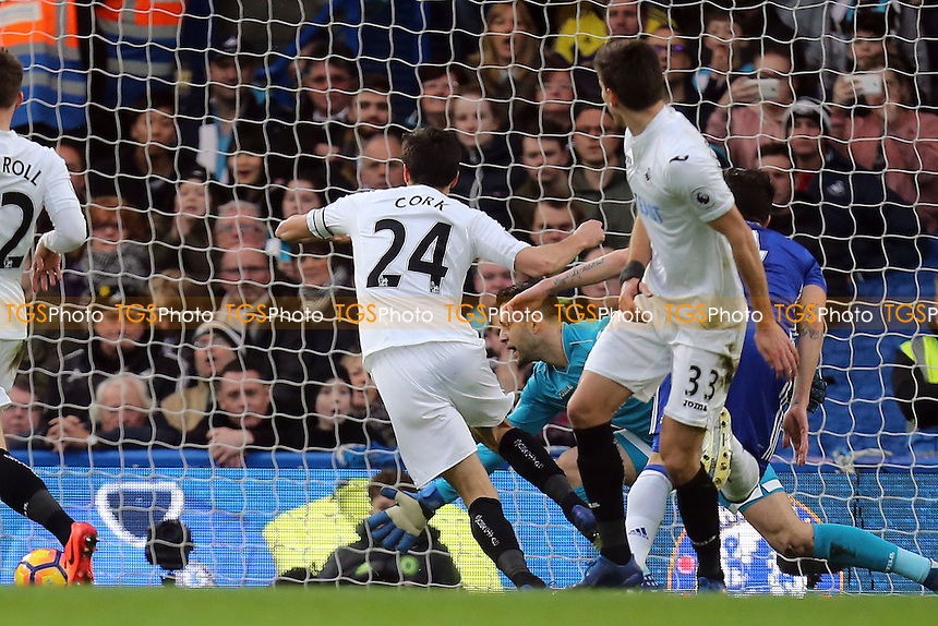 Cesc Fabregas of Chelsea (obscured scores the opening goal during Chelsea vs Swansea City, Premier League Football at Stamford Bridge on 25th February 2017