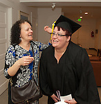 Susan Tirst, left helps WNC student Leah Clark get ready prior to commencement at the Western Nevada College in Fallon, Nev., on Tuesday, May 20, 2014. <br /> Photo by Kim Lamb