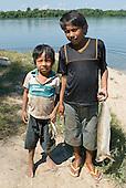 Mato Grosso State, Brazil. Aldeia Metuktire. Kayapo boys with fish.