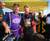 Feb 26, 2017; Chandler, AZ, USA; NHRA pro stock driver Greg Anderson with photographer Gary Nastase during the Arizona Nationals at Wild Horse Pass Motorsports Park. Mandatory Credit: Mark J. Rebilas-USA TODAY Sports