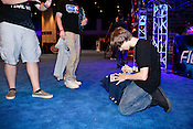 """August 29, 2010. Raleigh, North Carolina.. Justin Deese, ie  """"iGotUrPistola"""", of team Final Boss, signs autographs after his team won the $20,000 Halo 3 purse.. Major League Gaming (MLG), the league for professional videogame players, held their 50th Pro Circuit competition at the Raleigh Convention Center, with gamers from all over the country coming to for 3 days of competition in Halo 3, Tekken 6, Super Smash Bros. Brawl, Starcraft 2 and World of Warcraft."""